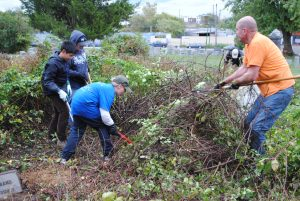 Scouts from the COLBSA Troop 503 of Media, PA had their hands full clearing out weeds and overgrown shrubbery during last Saturday's clean-up day at Mount Moriah Cemetery in Southwest Philadelphia. Photo Credit: Cradle of Liberty Council, Boy Scouts of America